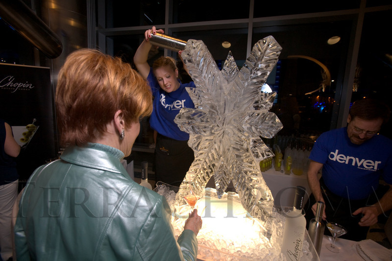 (Denver, Colo., Feb. 1, 2008)<br /> Heather Zeleski pours Sally Rippey a cocktail at the Chopin Martini Luge.  Denver Magazine launch party at the Cable Center in Denver, Colo., on Friday, Feb. 1, 2008.<br /> STEVE PETERSON