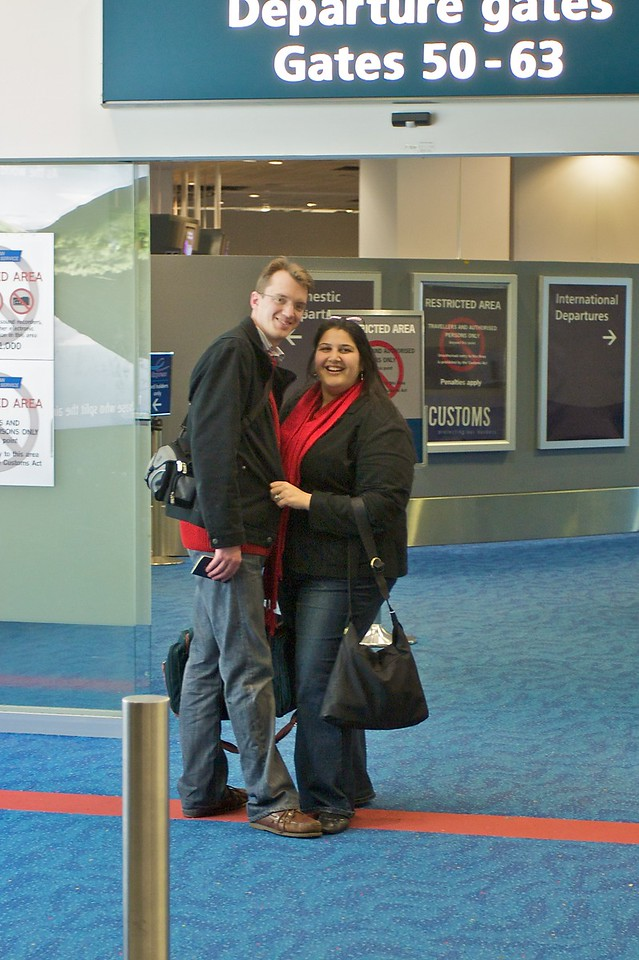 Thomas and Mary disappear airside as they leave for their honeymoon in Europe.