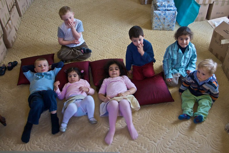 Children from four families watching television (<cite>Bee Movie</cite>!) at the family lunch held in Thomas' and Mary's new house on the Wednesday before their wedding.