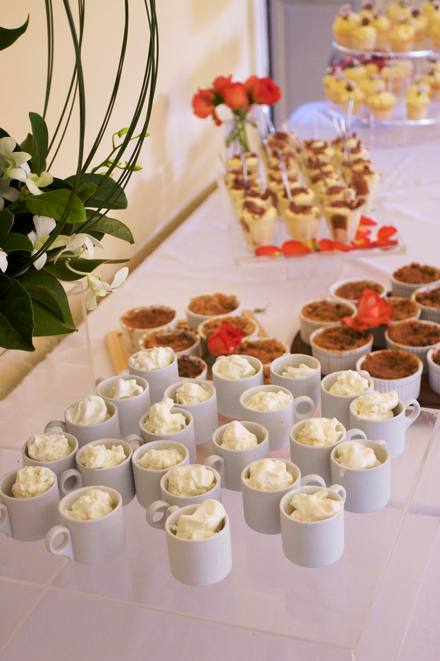 Dessert (ice cream, apple crumble, tiramisu, cupcakes) laid out by the caterer at the family lunch held in Thomas' and Mary's new house on the Wednesday before their wedding.