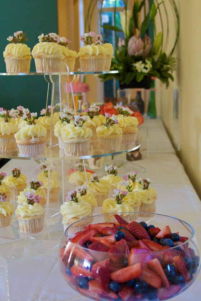 Dessert (fruit salad, cupcakes) laid out by the caterer at the family lunch held in Thomas' and Mary's new house on the Wednesday before their wedding.