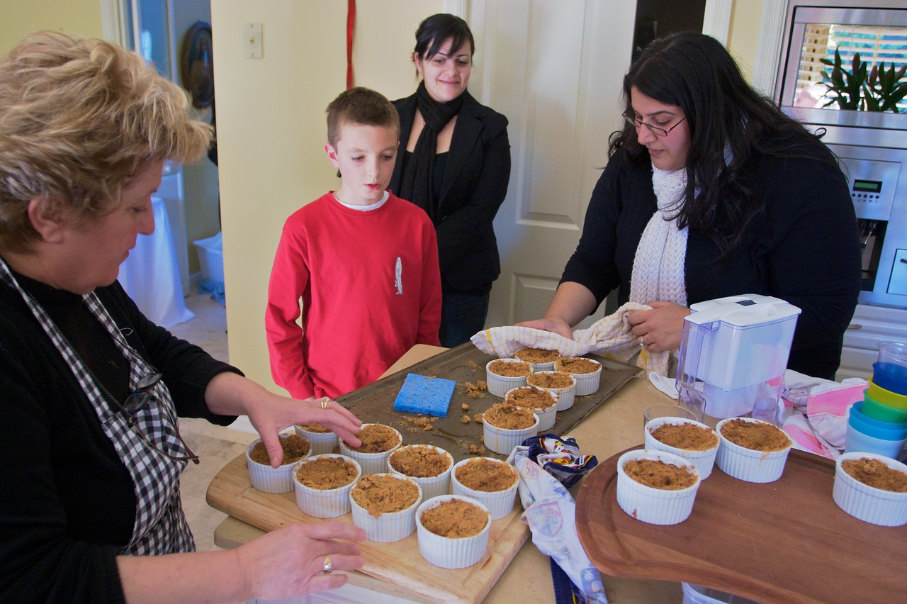 One of the caterers preparing the individual apple crumbles (with Mary's help) at the family lunch held in Thomas' and Mary's new house on the Wednesday before their wedding.