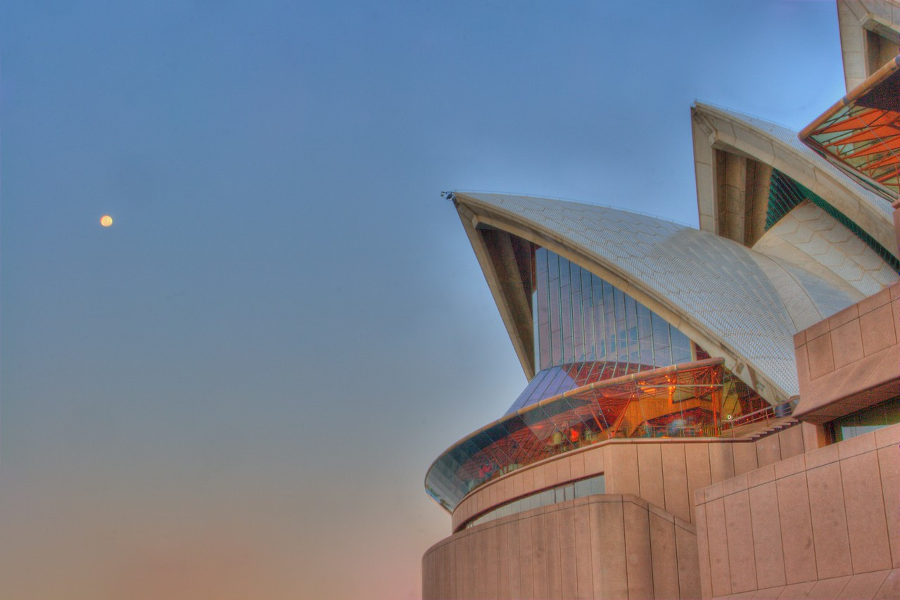 The moon over Sydney Opera House in July 2008.