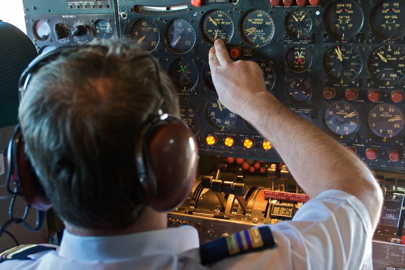 In the cockpit of the Lockheed Super Constellation VH-EAG the Flight Engineer prepares for takeoff from Illawarra Regional Airport.<br /> <br /> Before Thomas' wedding the men of the family were invited to go to HARS for the day when Mary held her Kitchen Tea for the ladies. The day included a flight on the Super Constellation.