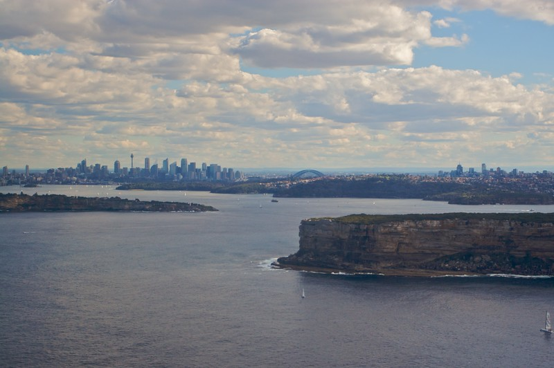 Sydney, looking over North and South Heads from the Pacific (in the east) towards the city. When surveying the east coast of Australia, Captain Cook initially dismissed what would later become Port Jackson/Sydney Harbour: he couldn't see over the rock of the heads and dismissed it as merely a rocky cove.<br /> <br /> Before Thomas' wedding the men of the family were invited to go to HARS for the day when Mary held her Kitchen Tea for the ladies. The day included a flight on the Super Constellation.