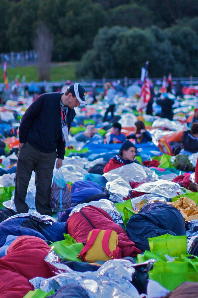 John peers in to someone's sleeping bag on the final day of the World Youth Day in Sydney, a few hours before the Pope's final Mass.