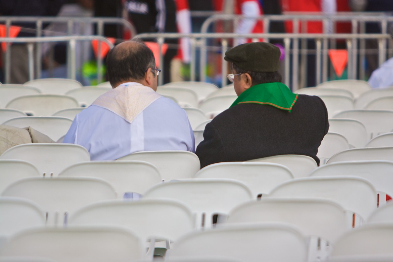 A couple of priests chatting before the final Mass of the World Youth Day in Sydney.