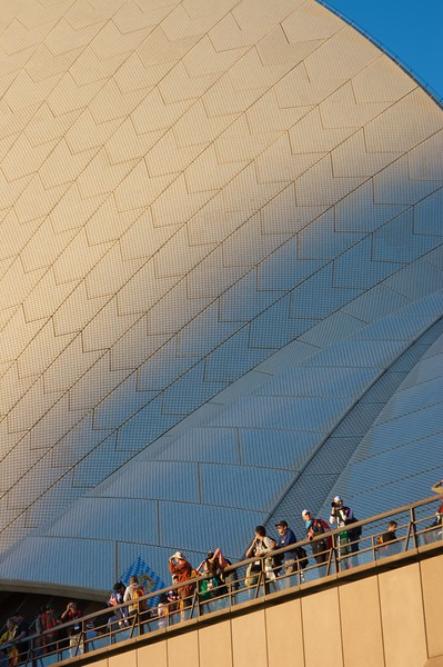 Pilgrims at the base of the sails of the Opera House.