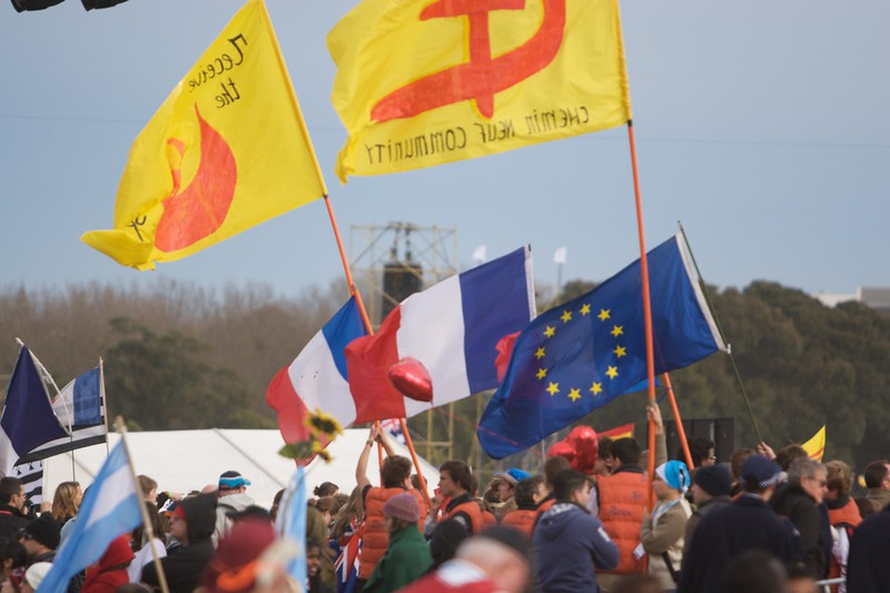 Flags being waved in front of the stage at Royal Randwick Racecourse in anticipation of the final Mass of the World Youth Day in Sydney, to be said by the Pope.
