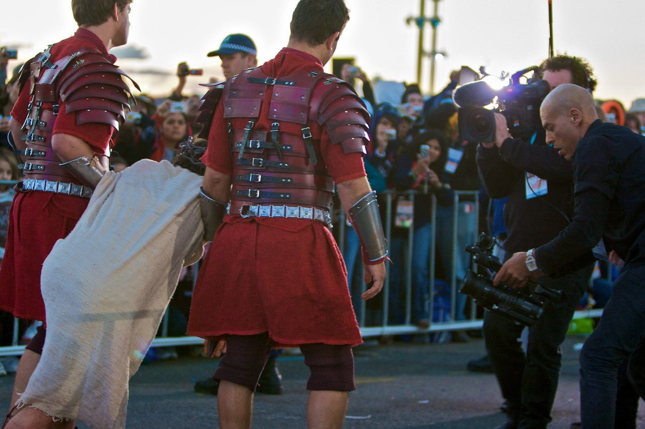 Christ being taken to Golgotha, preceded by a camera crew, in the re-enactment of the Stations of the Cross at the World Youth Day in Sydney.