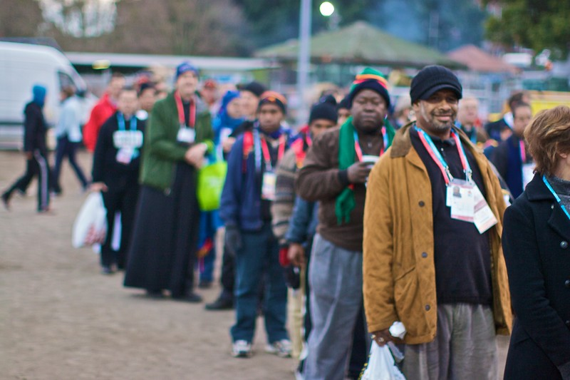 A queue of pilgrims waiting to go through the extra security needed for those allocated places close to the Pope's stage for the final Mass of the World Youth Day in Sydney.