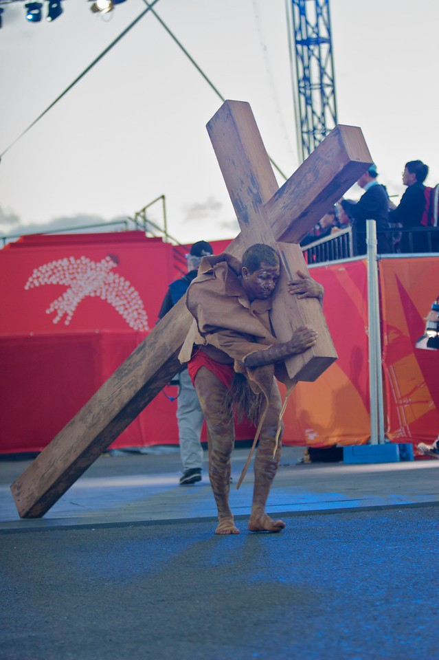 Simon of Cyrene carrying the Cross at the Stations of the Cross for the World Youth Day in Sydney.