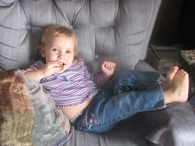 Kathryn chilling out, watching Elmo on TV, with her feet up!