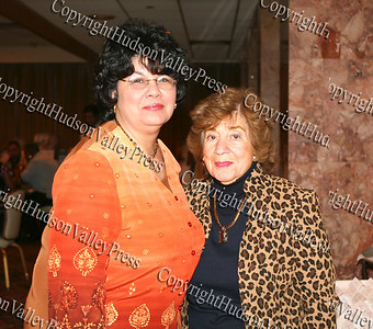 Joanne Lugo and Regina Angelo pose for a picture at the Greater Hudson Valley Family Health Center in Newburgh's second Baile Latino, held on May 17, 2008.
