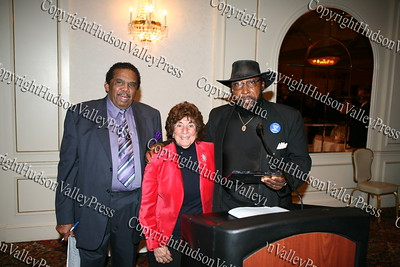 Runston Lewis and Edward Winfield, Jr present City of Newburgh Councilwoman Regina Angelo with her award during the Black and Hispanic Coalition's 13th Annual Fund Raiser and Dinner Dance at Anthony's Pier 9 on October 31, 2008.