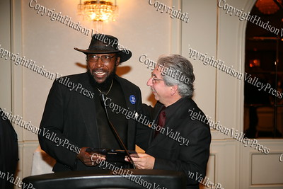 Edward Winfield, Jr presents City of Newburgh Mayor Nicholas Valentine with his award during the Black and Hispanic Coalition's 13th Annual Fund Raiser and Dinner Dance at Anthony's Pier 9 on October 31, 2008.