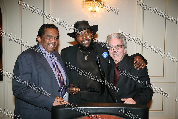 Runston Lewis and Edward Winfield, Jr present City of Newburgh Mayor Nicholas Valentine with his award during the Black and Hispanic Coalition's 13th Annual Fund Raiser and Dinner Dance at Anthony's Pier 9 on October 31, 2008.