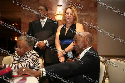 Mr Walter Grannum says a few words after being inducted into the Glenn Hines Boys & Girls Club Hall of Fame during the 1st Dinner Dance held at Anthony's Pier Nine in New Windsor on Friday, October 3, 2008. His wife Ester is seated beside him while Rev. Nelson McAllister stands with Kathy Parisi.