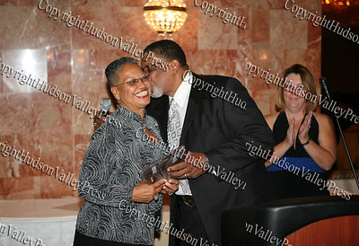 Henrietta Warner receives a kiss from Rev. Nelson McAllister after being honored at the Glenn Hines Boys & Girls Club 1st Dinner Dance held at Anthony's Pier Nine in New Windsor on Friday, October 3, 2008.