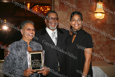 Rev. Nelson McAllister (center) with Henrietta Warner and her daughter Tara Miller after being honored at the Glenn Hines Boys & Girls Club 1st Dinner Dance held at Anthony's Pier Nine in New Windsor on Friday, October 3, 2008.