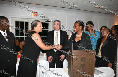 Ramona Burton is presented an award on behalf of Liberty Partnership Program by Tiombe Tallie Carter at the NAACP Freedom Fund Banquet held at the Spruce Lodge in Montgomery on Saturday, October 4, 2008.
