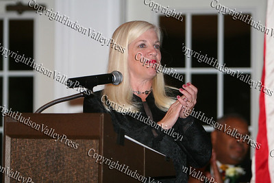 Sue Valentine applaudes the NAACP honoress at the NAACP Freedom Fund Banquet held at the Spruce Lodge in Montgomery on Saturday, October 4, 2008.