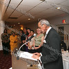 Jim Moss accepts an NAACP award on behalf of the Greater Hudson Valley Family Health Center as staff look on during the NAACP Freedom Fund Banquet held at the Spruce Lodge in Montgomery on Saturday, October 4, 2008.