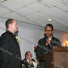 Father William Scafidi is presented his award by Tiombe Tallie Carter at the NAACP Freedom Fund Banquet held at the Spruce Lodge in Montgomery on Saturday, October 4, 2008.