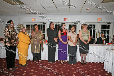 Greater Hudson Valley Family Health Center staff listen as Jim Moss accepts an NAACP award on behalf of the organization during the NAACP Freedom Fund Banquet held at the Spruce Lodge in Montgomery on Saturday, October 4, 2008.