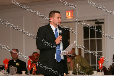 JJ Hanson, a representative from New York State Gov David Paterson's office, offers congradulations on behalf of the governor at the NAACP Freedom Fund Banquet held at the Spruce Lodge in Montgomery on Saturday, October 4, 2008.
