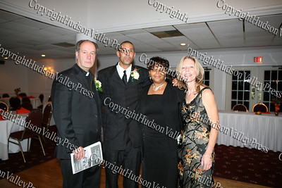 Father William Scafidi, Harold Rayford and his wife Hillary, pose with Pam Krizek at the NAACP Freedom Fund Banquet held at the Spruce Lodge in Montgomery on Saturday, October 4, 2008.