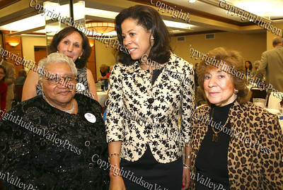 Roxie Royal and Regina Angelo greet New York's first lady Michelle Paterson during the annual Orange County Democratic Women's dinner. Sandra Sciortino in background.