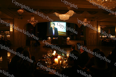 Attendees of the Greater Hudson Valley Family Health Center's 9th Annual Pillars of the Community Gala held at Anthony's Pier 9 on Saturday, November 8, 2008, watch a video presentation.
