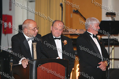 Dr. John D'Ambrosio (at podium) introduces honorees Jim Taylor and Jim Smith who were the recipients of the Lifetime Achievement Award at the 9th Annual Pillars of the community Gala held at Anthony's Pier 9 on Saturday, November 8, 2008.