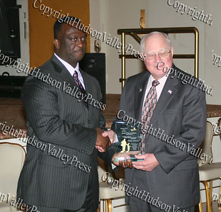 Glen Fraser presents Sen. William Larkin with an award during the 10th Annual Tuskegee Airmen Tuition Assistance Dinner, held on February 2, 2008, at Anthony's Pier 9 in New Windsor, New York.
