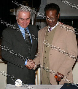 Congressman Maurice Hinchey presents Isaiah Robinson, an original Tuskegee Airmen, with the Congressional Medal of Honor during the 10th Annual Tuskegee Airmen Tuition Assistance Dinner, held on February 2, 2008, at Anthony's Pier 9 in New Windsor, New York.