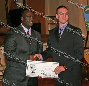 Glen Fraser presents Austin Brochetti with his scholarship during the 10th Annual Tuskegee Airmen Tuition Assistance Dinner, held on February 2, 2008, at Anthony's Pier 9 in New Windsor, New York.