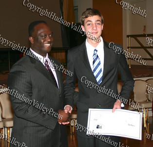 Glen Fraiser presents Jeffrey Arndt with his scholarship during the 10th Annual Tuskegee Airmen Tuition Assistance Dinner, held on February 2, 2008, at Anthony's Pier 9 in New Windsor, New York.