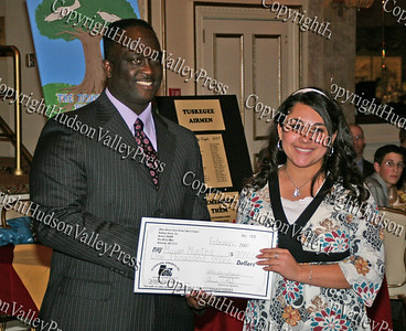 Glen Fraser presents Miriam Montes with her scholarship during the 10th Annual Tuskegee Airmen Tuition Assistance Dinner, held on February 2, 2008, at Anthony's Pier 9 in New Windsor, New York.