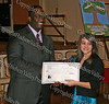 Glen Fraser presents Caitlyn Hitt with her scholarship during the 10th Annual Tuskegee Airmen Tuition Assistance Dinner, held on February 2, 2008, at Anthony's Pier 9 in New Windsor, New York.