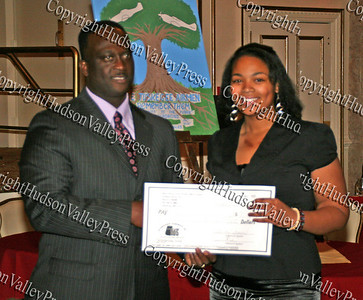 Glen Fraser presents Nia Newton with her scholarship during the 10th Annual Tuskegee Airmen Tuition Assistance Dinner, held on February 2, 2008, at Anthony's Pier 9 in New Windsor, New York.