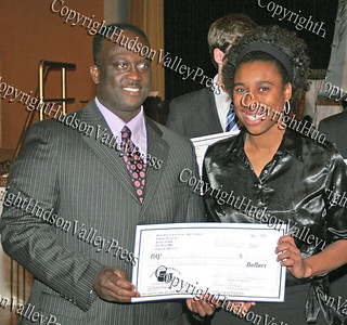 Glen Fraser presents Paris West with her scholarship during the 10th Annual Tuskegee Airmen Tuition Assistance Dinner, held on February 2, 2008, at Anthony's Pier 9 in New Windsor, New York.