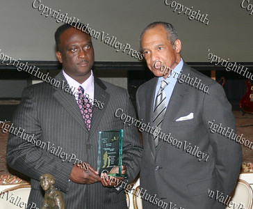 Glen Fraser presents James Moss with an award during the 10th Annual Tuskegee Airmen Tuition Assistance Dinner, held on February 2, 2008, at Anthony's Pier 9 in New Windsor, New York.