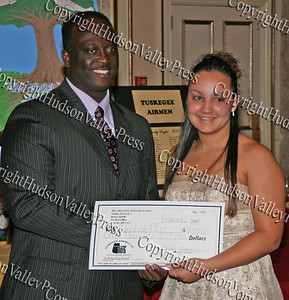 Glen Fraser presents Candice Otero with her scholarship during the 10th Annual Tuskegee Airmen Tuition Assistance Dinner, held on February 2, 2008, at Anthony's Pier 9 in New Windsor, New York.