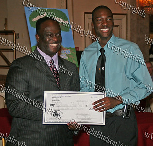 Glen Fraser presents Richard Mitchell with his scholarship during the 10th Annual Tuskegee Airmen Tuition Assistance Dinner, held on February 2, 2008, at Anthony's Pier 9 in New Windsor, New York.