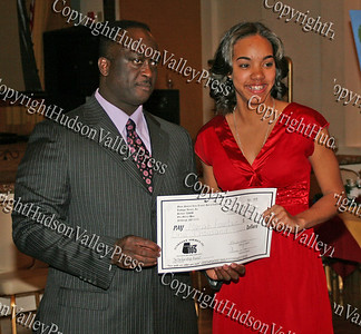 Glen Fraser presents Mariah Fountain with her scholarship during the 10th Annual Tuskegee Airmen Tuition Assistance Dinner, held on February 2, 2008, at Anthony's Pier 9 in New Windsor, New York.
