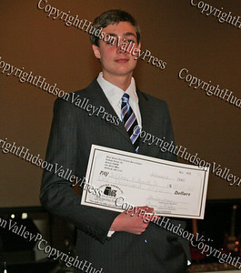 Jeffrey Arndt with his scholarship during the 10th Annual Tuskegee Airmen Tuition Assistance Dinner, held on February 2, 2008, at Anthony's Pier 9 in New Windsor, New York.