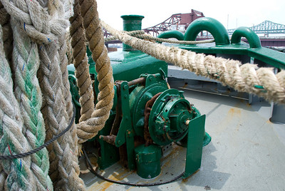 Look at the size of the ropes - they're huge!  I'm not sure what the machine might be... anchor possibly?