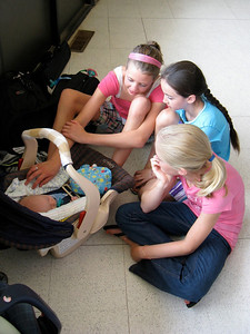 Cousins Elizabeth, Shannon, and Olivia observe Charlie