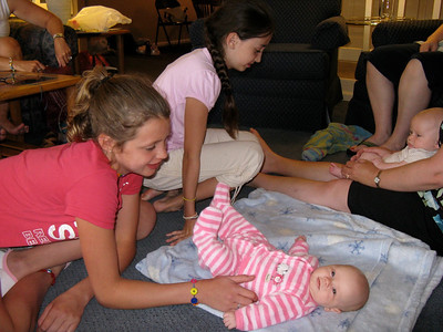 Elizabeth tickles Flora